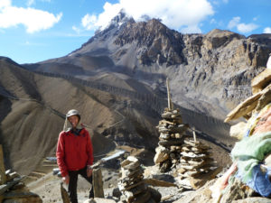 A trekker posing at Thoron La Pass