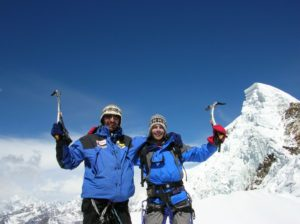 climbers posing at Lobuche peak